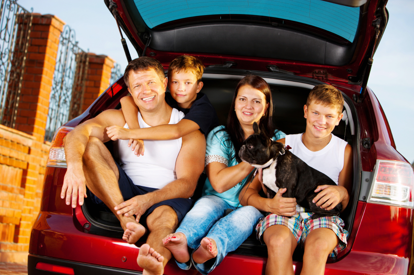 Happy Family with French Bulldog in car ready for travel